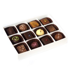 Twelve handmade truffles packed in a large box