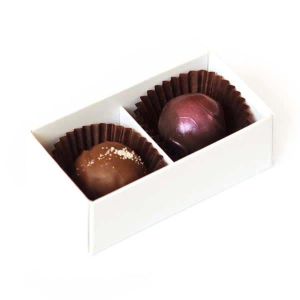 Two handmade truffles packed in a small box