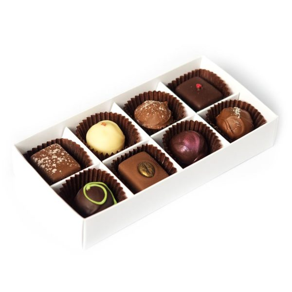 Eight handmade truffles packed in a large box