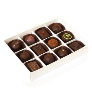 Twelve handmade dark truffles packed in a large box