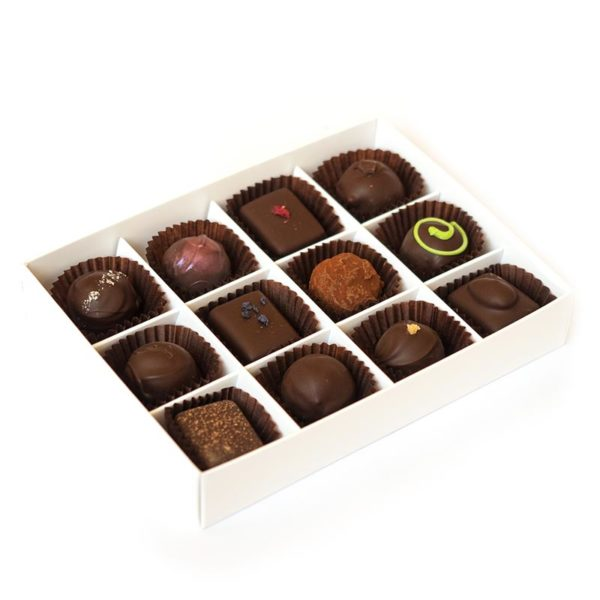 Twelve handmade dark truffles packed in a large box