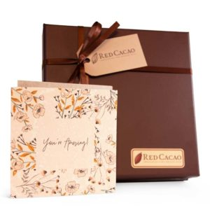 Sixteen piece truffle box with a card included to send a spacial message to a loved one. The card says 'You're Amazing'.