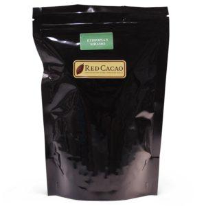 A black bag of 500 gram freshly roasted coffee beans