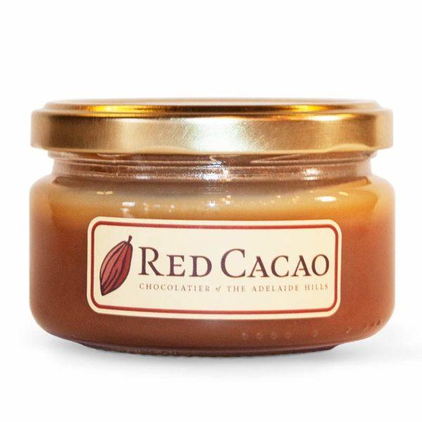 A large jar of salted caramel sauce